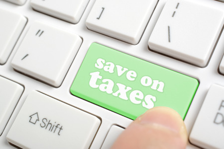 Pressing green save on taxes key on keyboard Imagens