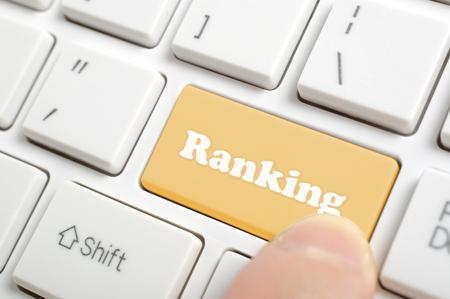 pressing: Pressing brown ranking key on keyboard Stock Photo