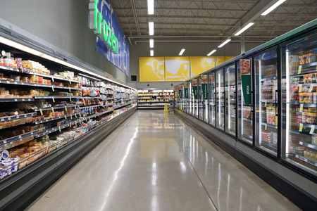 Port Coquitlam BC Canada - March 16, 2015 : Dairy and fozen food corridor in Save on Foods. It is a regional chain of supermarkets located in British Columbia, Canada.