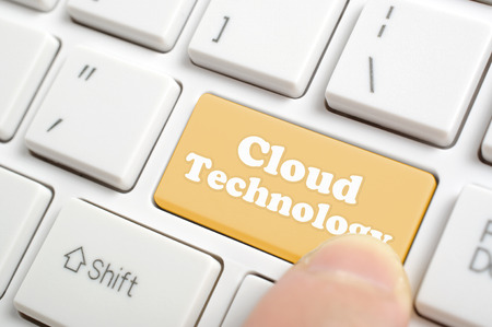 Pressing brown cloud technology key on keyboard Imagens