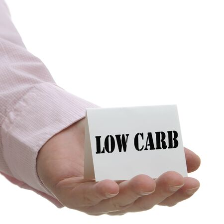 carb: Business man holding low carb sign on hand