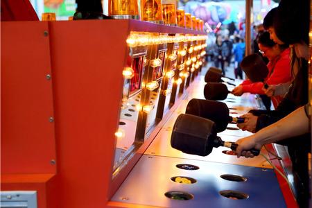 whack: People playing whack game at carnival