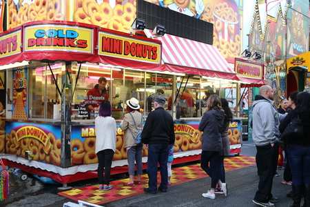 Coquitlam, BC, Canada - April 10, 2015 : Peopke line up for buying food at the West Coast Amusements Carnival