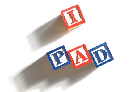 i pad: Alphabet Blocks spelling the words i pad Stock Photo