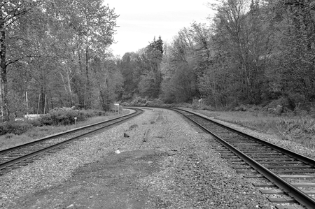 black and white railroad tracks: Railroad tracks with black and white toned Stock Photo