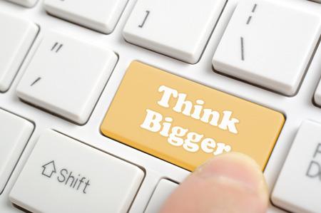 bigger: Pressing brown think bigger key on keyboard