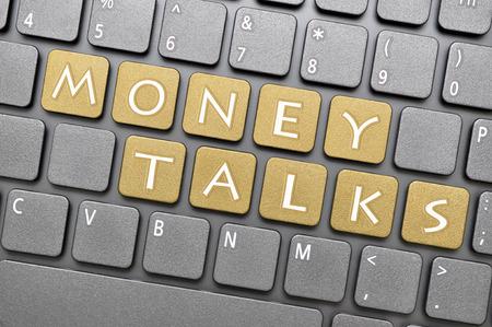 talks: Golden money talks key on keyboard Stock Photo