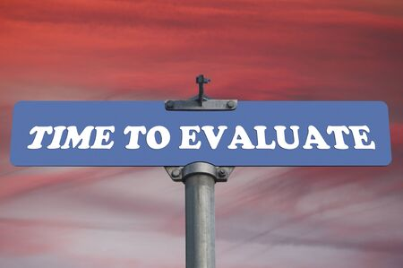 evaluate: Time to evaluate road sign Stock Photo