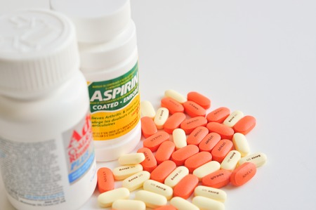 prescription bottle: Pills of aspirin and advil