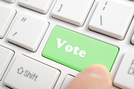 electronic voting: Pressing green vote key on keyboard