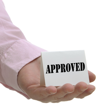 approved sign: Business man holding approved sign on hand Stock Photo