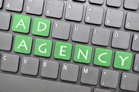 ad: Green ad agency key on keyboard
