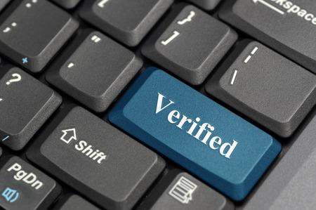 Blue verified key on keyboard