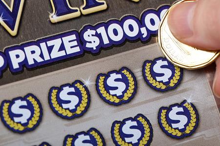sanctioned: Coquitlam BC Canada - October 24, 2015 : Woman scratching lottery tickets. The British Columbia Lottery Corporation has provided government sanctioned lottery games in British Columbia since 1985. Editorial