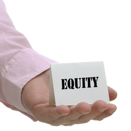 equidad: Business man holding equity sign on hand