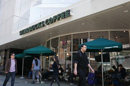 Vancouver, BC, Canada - April 22, 2016 : One side of Starbucks coffee on sunny day in downtown Vancouver