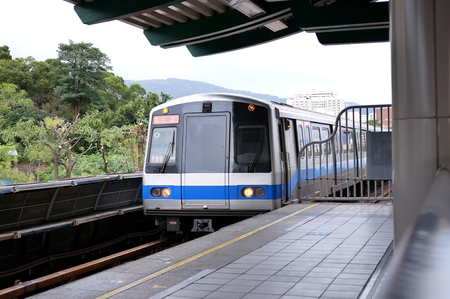 Motion of mass rapid transit arriving at the platform in Taipei Taiwan Stock Photo