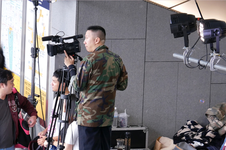 Taipei, Taiwan - December 02, 2017 : Top shot of video operator with camcorder on tripods recording video at an event Editorial