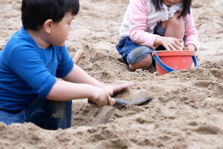 Taipei, Taiwan - December 02, 2017 : One side of children playing with mud at park Editorial