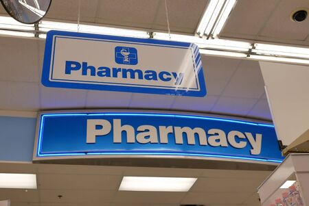 Close up of pharmacy sign hanging on store Archivio Fotografico
