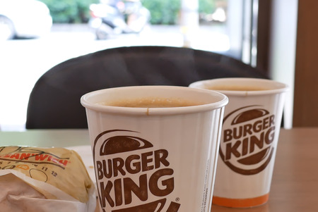 Taipei, Taiwan - August 17, 2018 : Motion of hot coffee with steam at Burger King fast food restaurant
