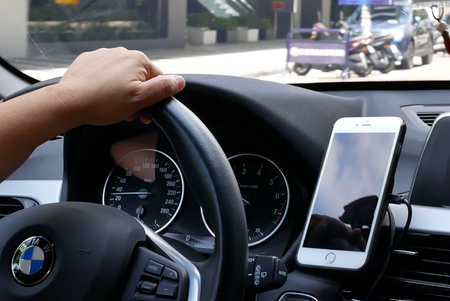 Taipei, Taiwan - August 25, 2018 : Motion of car driving on road and focusing on car dashboard Editoriali