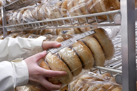 Close up of people buying bagel inside Costco store