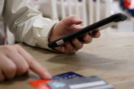 Motion of woman typing credit card number for buying gift on smart phone