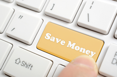 Pressing brown saving money key on keyboard