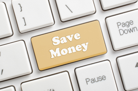 Brown saving money key on keyboard Archivio Fotografico