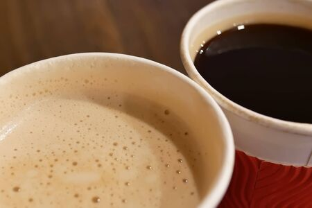 Close up of two cup of hot coffee on table at food court