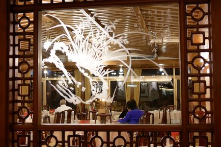 Motion of people enjoy food inside Chinese restaurant