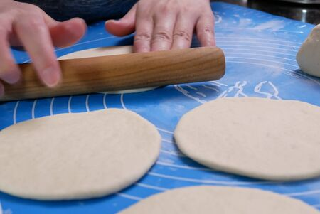 Motion of people kneading the dough and shaping it with their hands to steam bun at home Archivio Fotografico