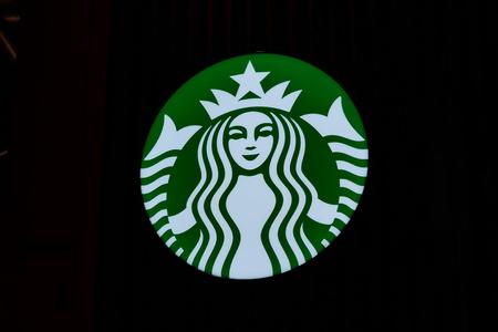 Close up of Starbucks logo on dark night Archivio Fotografico - 133173019