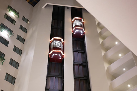 One side of people taking elevator inside the shopping mall in Taiwan