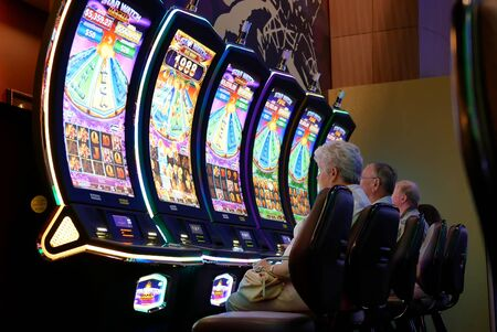 Coquitlam, BC, Canada - May 31, 2019 : Motion of people playing slot machine inside Casino Archivio Fotografico - 137901189
