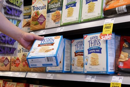 Burnaby, BC, Canada - May 09, 2019 : Motion of people buying rice cookie inside price smart foods store Archivio Fotografico - 137901205