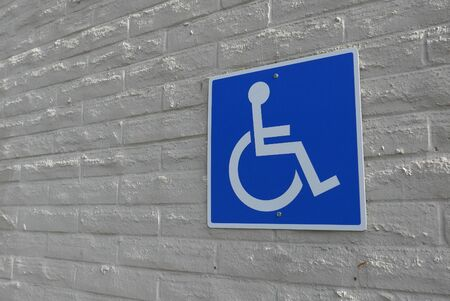 Motion of handicapped parking sign on wall