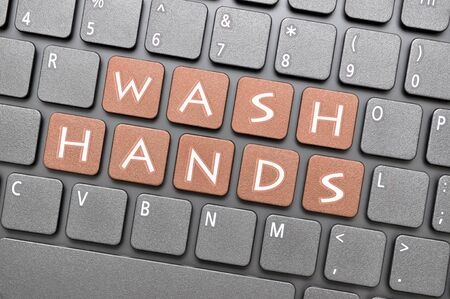 Wash hands key on keyboard Archivio Fotografico - 144338075