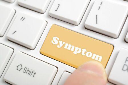 Pressing brown symptom key on keyboard Archivio Fotografico - 143278777