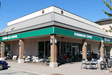 Store front of Starbucks coffee shop on sunny day in Coquitlam Canada Editoriali