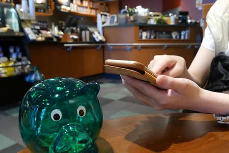 Hand browsing website on iphone inside Starbucks store Editoriali