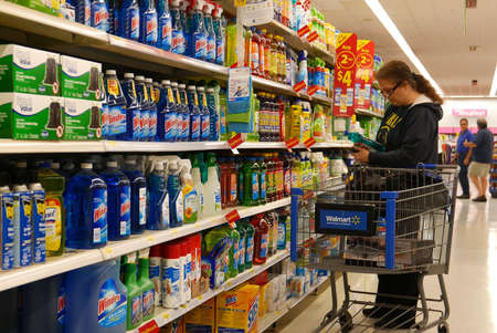 Woman buying cleaning product inside Walmart store Archivio Fotografico - 144363102