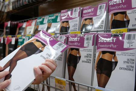 Woman buying Secret control panty inside Walmart store