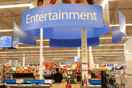 Motion of entertainment sign on top and people looking for buying tv inside Walmart store Editorial