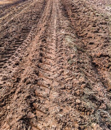 furrow: Furrow of tractor on farm Stock Photo