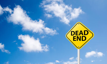 dead end sign on blue sky background photo
