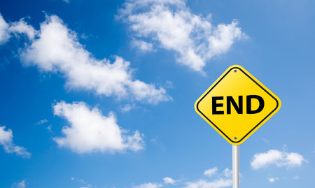 end sign on blue sky background photo