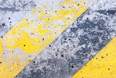 yellow line: grunge cement background with old yellow line Stock Photo