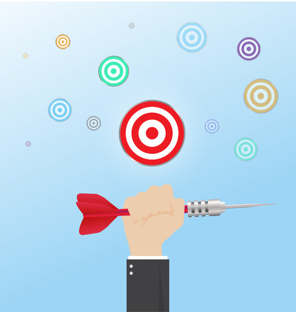 success concept: hand of businessman with Hit the Bullseye,Business success concept